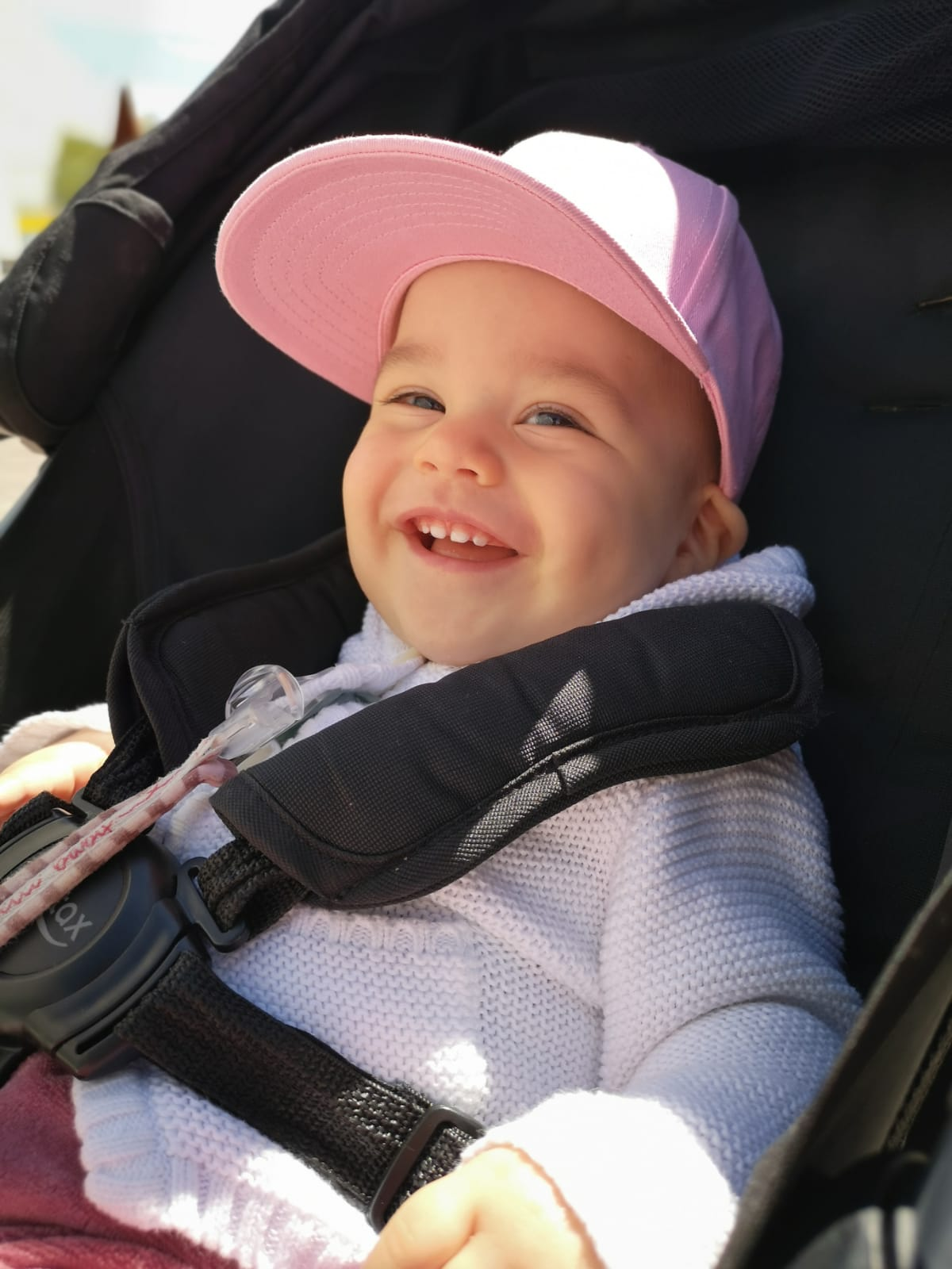 Infant baby girl wearing a pink snapback cap from myBabyCap